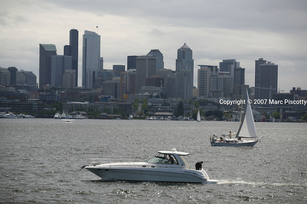 SHOT 5/19/2007 and 5/20/2007 - Images of Seattle, Washington including a powerboat and a sailboat in the bay near Gas Works Park with the city's skyline in the background. Gas Works Park is a 20 acre public park on Lake Union that was cleared in 1906 to construct a plant to manufacture gas from coal but in 1962 the city of Seattle acquired it to create a park with a view of the city's skyline. .(Photo by Marc Piscotty © 2007)
