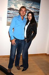 Artist GEORGE LEWIS and his wife ELIZABETH at a private view of paintings by George Lewis held at the Air Gallery, 32 Dover Street, London W1 on 5th October 2005.<br />