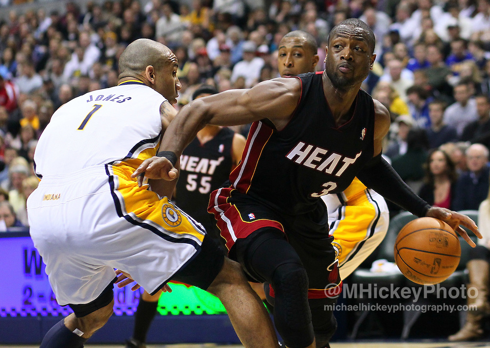 Feb. 15, 2011; Indianapolis, IN, USA; Miami Heat shooting guard Dwyane Wade (3) drives to the basket against Indiana Pacers guard Dahntay Jones (1) at Conseco Fieldhouse. Miami defeated Indiana 110-103. Mandatory credit: Michael Hickey-US PRESSWIRE
