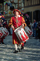 February 1992, Wolfach, Germany --- A costumed drummer marches in a Fasching parade, a pre-Lent celebration in Wolfach, West Germany. --- Image by © Owen Franken/CORBIS