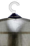 back view of button down shirt on a coathanger