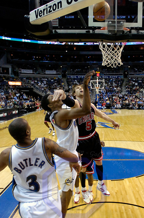 19 December 2007:   Chicago Bulls forward Andres Nocioni (5) fouls Washington Wizards forward Nick Young (1) as he scores 2 of his 8 points in the first half at the Verizon Center in Washington, D.C.  The Bulls defeated the Wizards 95-84.