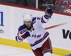Mar 25, 2010; Newark, NJ, USA; New York Rangers center Chris Drury (23) celebrates scoring the tying goal past New Jersey Devils goalie Martin Brodeur (30) in the last minute of the third period at the Prudential Center. The Rangers won 4-3 in an overtime shootout.