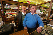 Vienna. Zum schwarzen Kameel. Owner and Director Peter Friese (l.) with the cashier.