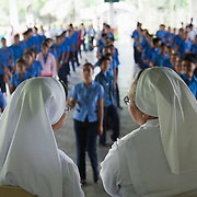 Teenagers, both girls and boys line up at the beginning of the day in front of Sister Mary Vic and her fellow sister.  Many of the local teenagers dream of going to Manila or other big cities and vocational training provided by Laura Vicuña is important to fulfil this dream. Casa Maria Ausilitrice Laura Vicuña Women Development and Training Centre in Victorias City. Laura Vicuña is a non-profit charity working in Manila and in Bacolod in the state Negros Occidental in the Philippines.Laura Vicuna, a charity working in Manila and in Bocalod in Negros Occidental in the Philippines.
