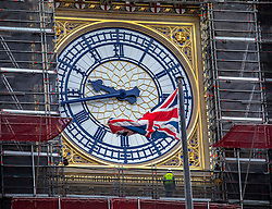 © Licensed to London News Pictures. 14/01/2020. London, UK. A construction worker inspects Big Ben this morning after MPs decide that Big Ben will not bong for Brexit as the £500,000 bill for replacing the flooring is too high. Several MPs had asked for the bell to ring on 31 January 2020 to mark the UK's departure from the EU. Photo credit: Alex Lentati/LNP