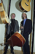 Guitar maker, Andy Webb and Mike rutherford. The Craft of the Luthier. An exhibition of British handmade guitars. Linley. 25 April 2001. © Copyright Photograph by Dafydd Jones 66 Stockwell Park Rd. London SW9 0DA Tel 020 7733 0108 www.dafjones.com