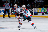 KELOWNA, CANADA - APRIL 19: Colten Martin #8 of the Kelowna Rockets skates with the puck against the Portland Winterhawks on April 18, 2014 during Game 2 of the third round of WHL Playoffs at Prospera Place in Kelowna, British Columbia, Canada.   (Photo by Marissa Baecker/Shoot the Breeze)  *** Local Caption *** Colten Martin;