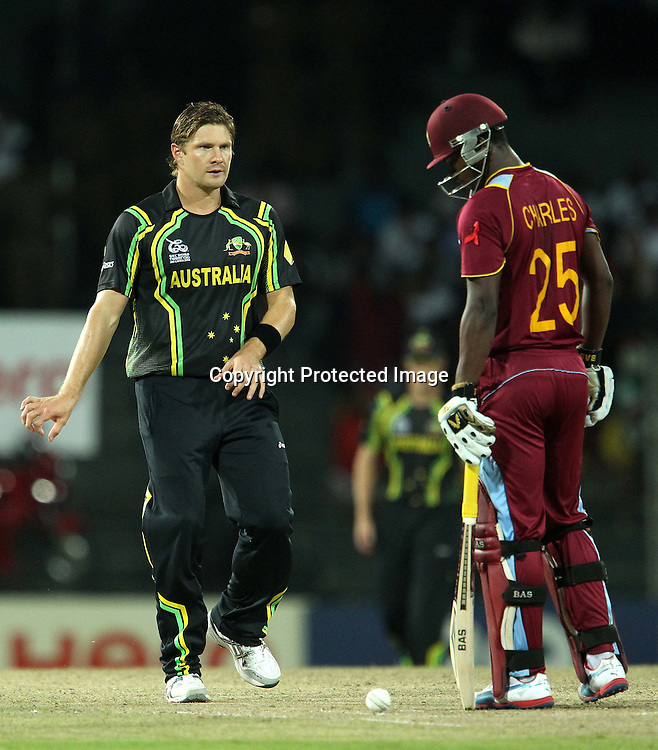 Shane Watson glares at Johnson Charles of The West Indies during the ICC World Twenty20 semi final match between Australia and The West Indies held at the Premadasa Stadium in Colombo, Sri Lanka on the 5th October 2012<br /> <br /> Photo by Ron Gaunt/SPORTZPICS