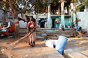 A women sweeps the dusty floor outside her house that is built in to the original structure that lined Hampi Bazaar. Founded in 1336, Vijayanagar was the capital of an alliance of southern Hindu kingdoms that ruled southern India for hundreds of years and left a sprawling architectural wonderland of magnificent temple ruins set amongst an otherworldly landscape of gigantic sandstone boulders, meandering streams and banana plantation near the village of Hampi in the state of Karnataka. The temples, spread over an area of 25 square kilometers and 58 of its 550 buildings were declared UNESCO World Heritage Sites in 1986. Other than the Taj Mahal, no other monument in India is written about as much as Hampi. But the millions of visitors who visit those other architectural sites have yet to show serious interest in Hampi, which is remote, lacks infrastructure and is hardly publicized.