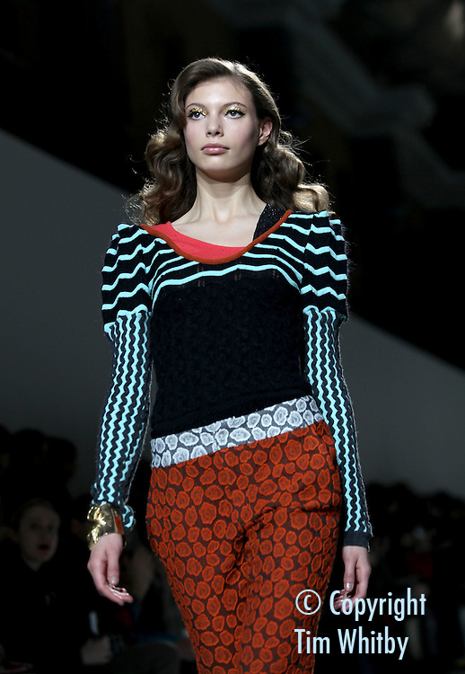 LONDON, ENGLAND - FEBRUARY 20:  A model walks the runway during the PMichael van der Ham show at London Fashion Week Autumn/Winter 2012 at Topshop Venue, Old Billingsgate Market  on February 20, 2012 in London, England  (Photo by Tim Whitby/Getty Images)