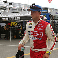 Trevor Bayne is seen in the garage area during the first practice session of the 56th Annual NASCAR Coke Zero400 race at Daytona International Speedway on Thursday, July 3, 2014 in Daytona Beach, Florida.  (AP Photo/Alex Menendez)