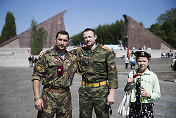 May 9, 2018 - Berlin, Germany - Ayrat, Konstantin and Sophia from Novosibirsk  pose for a picture on the 73rd anniversary of the victory of the Soviet Red Army over Nazi Germany at the Soviet World War II cemetery and memorial in Treptow on May 9, 2018 in Berlin, Germany. (Credit Image: © Emmanuele Contini/NurPhoto via ZUMA Press)