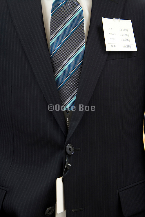 black male business suite with sales label