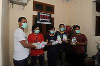 Medan, Indonesia, March 27, 2020: Indonesian photojournalist seen giving care for the team to take care for health protection during Corona Virus Disease 19 spread warning in Medan secretariat office in North Sumatra province, Indonesia on March 27, 2020.
