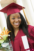Graduate Holding Flowers and Diploma portrait