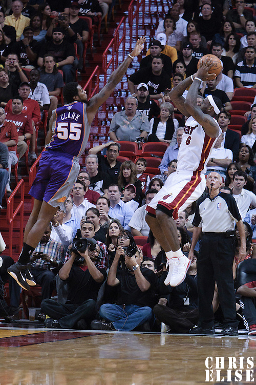 17 November 2010: Miami Heat's small forward #6 LeBron James takes a jumpshot over Phoenix Suns' forward #55 Earl Clark during the Miami Heat 123-96 victory over the Phoenix Suns at the AmericanAirlines Arena, Miami, Florida, USA.
