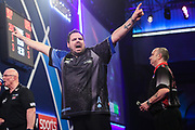 Adrian Lewis hits a double and wins a leg and celebrates during the PDC William Hill World Darts Championship at Alexandra Palace, London, United Kingdom on 23 December 2019.