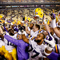 November 17, 2012; Baton Rouge, LA, USA;  LSU Tigers head coach Les Miles and his team celebrate following a win over the Ole Miss Rebels in a game at Tiger Stadium. LSU defeated Ole Miss 41-35. Mandatory Credit: Derick E. Hingle-US PRESSWIRE