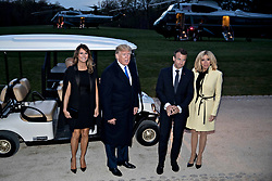 U.S. President Donald Trump, second left, speaks to members of the media next to a golf cart following a dinner with U.S. First Lady Melania Trump, from left, Emmanuel Macron, France's president, and Brigitte Macron, France's first lady, at the Mount Vernon estate of first U.S. President George Washington in Mount Vernon, Virginia, U.S., on Monday, April 23, 2018. As Macron arrives for the first state visit of Trump's presidency, the U.S. leader is threatening to upend the global trading system with tariffs on China, maybe Europe too. Photographer: Andrew Harrer/Bloomberg