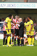 The ref sends George McLennan off during the Vanarama National League match between Torquay United and Cheltenham Town at Plainmoor, Torquay, England on 29 August 2015. Photo by Antony Thompson.