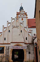 """Frohes Fest"" sign on an arched portal at Chemnitz Castle in Germany."
