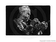 Berlin, DEU, 19.09.1994: Don Cherry mit Pocket-Trumpet, bei einem Konzert im Quasimodo Jazzclub Berlin ,(Film 1269 Bild 32), SCHILKE_1994091912693200 [ Photo-copyright: Detlev Schilke, Postfach 350802, 10217 Berlin, Germany, Mobile: +49 (0)170 3110119, www.detschilke.de - Jegliche Nutzung nur gegen Honorar nach MFM, Urhebernachweis nach Par. 13 UrhG und Belegexemplare. Only editorial use, advertising after agreement! Eventuell notwendige Einholung von Rechten Dritter wird nicht zugesichert, falls nicht anders vermerkt. AGB/TERMS: http://www.detschilke.de/terms.html ]