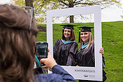 Patton College of Education graduate students Carly Dye, left, and Kristina Cox pose for a photo before the start of Graduate Commencement ceremonies on Friday, May 1, 2015.  Photo by Ohio University  /  Rob Hardin