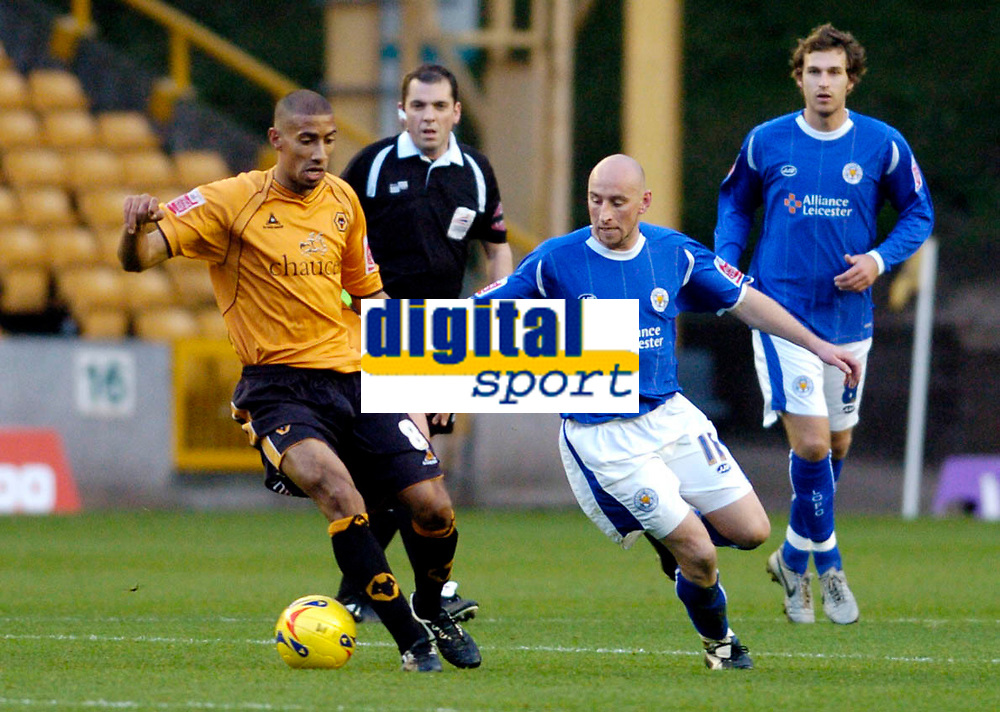 Photo: Leigh Quinnell.<br /> Wolverhampton Wanderers v Leicester City. Coca Cola Championship. 09/12/2006. Referee Phil Dowd keeps an eye on Wolves' Karl Henry and Leicesters Danny Tiatto.