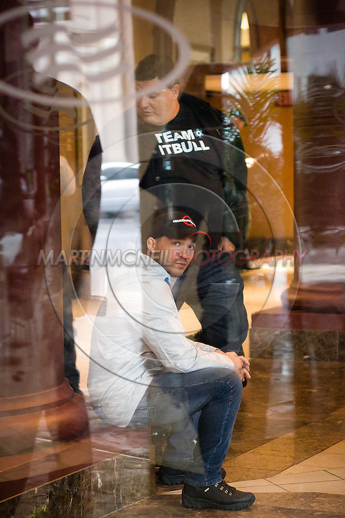 "ST. LOUIS, MO, JUNE 19, 2015: Patricio ""Pitbull"" Freire sits in the lobby of the Crowne Plaza hotel, waiting for his ride to the  Scottrade Center for his fight at Bellator 138 in St. Louis, Missouri © Sara Levin"