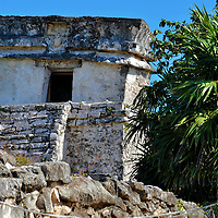 Temple of the Descending God at Mayan Ruins in Tulum, Mexico<br /> The Temple of the Descending God derived its name from the relief above the door. The carving shows an upside-down male figure. At the vernal or spring equinox a ray of sunlight streams below it. Some archeologists believe this sculpture on the Templo del Dios Descendente represents Ah-Muzen-Cab, the Mayan god of bees and honey. Similar icons are found throughout Tulum and other nearby Mayan ruins. His counterpart is Colel Cab, the goddess of bees.