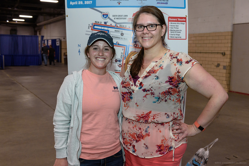 Runners pick up their athlete packets and shop in the vendor mall at Kentucky Derby Festival's Race Expo and Packet Pickup Thursday, April 27, 2017, in the West Wing of the Kentucky ExpositionCenter in Louisville, Ky. (Photo by Brian Bohannon)