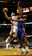 PHOTO BY DAVID RICHARD.Detroit's Ben Wallace plays a tight defense on LeBron James of Cleveland last night in the fourth quarter.