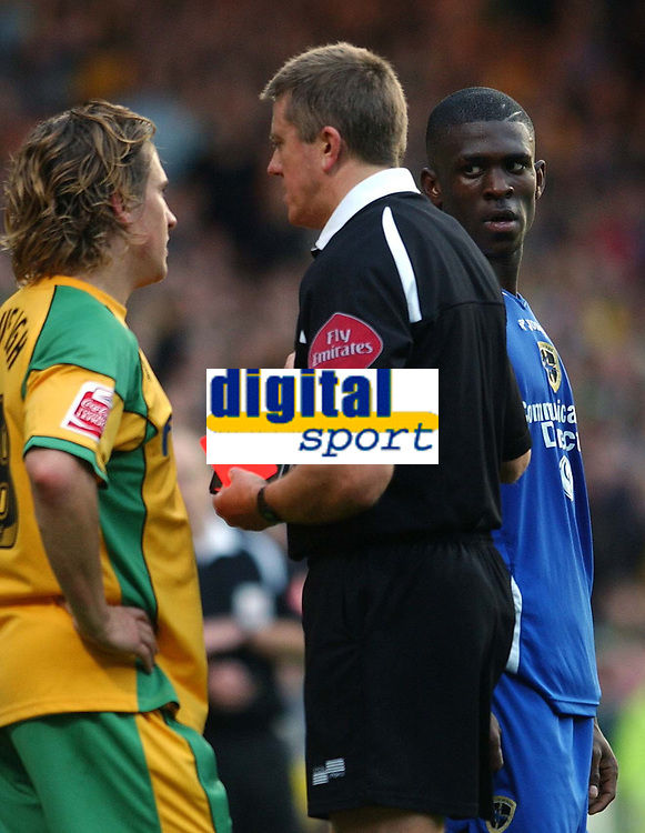 Photo: Ashley Pickering.<br />Norwich City v Cardiff City. Coca Cola Championship. 21/10/2006.<br />Kerrea Gilbert (R) looks at the ref after recieving a red card for his challenge on Norwich's Paul McVeigh (L).