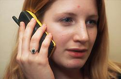 Teenage girl talking on mobile phone,