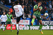 Bolton Wanderers defender Derik Osede (15) clearance is nearly closed down by AFC Wimbeldon midfielder Tom Soares (14)  during the EFL Sky Bet League 1 match between Bolton Wanderers and AFC Wimbledon at the Macron Stadium, Bolton, England on 4 March 2017. Photo by Simon Davies.