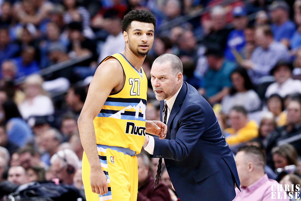 04 March 2017: Denver Nuggets head coach Michael Malone talks to Denver Nuggets guard Jamal Murray (27) during the Charlotte Hornets 112-102 victory over the Denver Nuggets, at the Pepsi Center, Denver, Colorado, USA.