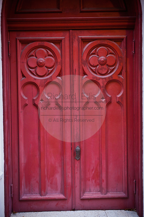 Old red wooden church door in Savannah, Georgia, USA.