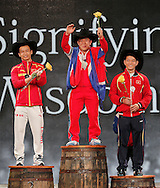 Nov 21, 2015; Houston, TX, USA; World Champion podium winners of the mens 56kg division is gold medal winner Yun Chol Om , North Korea (center) , bronze medal winner Jingbiao Wu, China, (left) and bronze medal winner Kim Tuan Thach , Vietman (right) at the International Weightlifting Federation World Championships at George R. Brown Convention Center. Mandatory Credit: Thomas B. Shea-USA TODAY Sports
