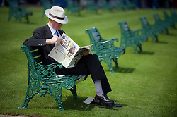 © licensed to London News Pictures. 14/06/2011. Ascot, UK.  On man reads the racing post on Day one at Royal Ascot races today (14/03/2011). The 5 day showcase event,  one of the highlights of the racing calendar is in it's 300th year. Horse racing has been held at the famous Berkshire course since 1711 and tradition is a hallmark of the meeting. Top hats and tails remain compulsory in parts of the course. Photo credit should read: Ben Cawthra/LNP