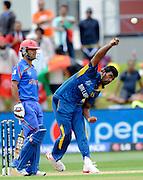 Thisara Perera bowls for Sri Lanka during the ICC Cricket World Cup match between Afghanistan and Sri Lanka at university oval in Dunedin, New Zealand. Photo: Richard Hood/photosport.co.nz