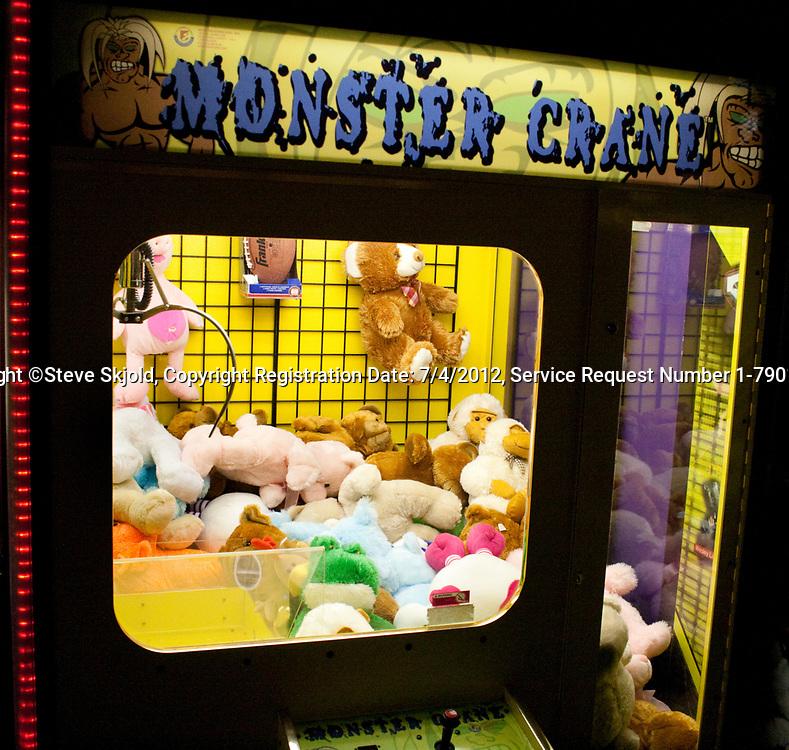 Monster Crane Giant Claw Redemption Machine arcade animal pick up game. Grand Slam Amusement Center Burnsville Minnesota MN USA