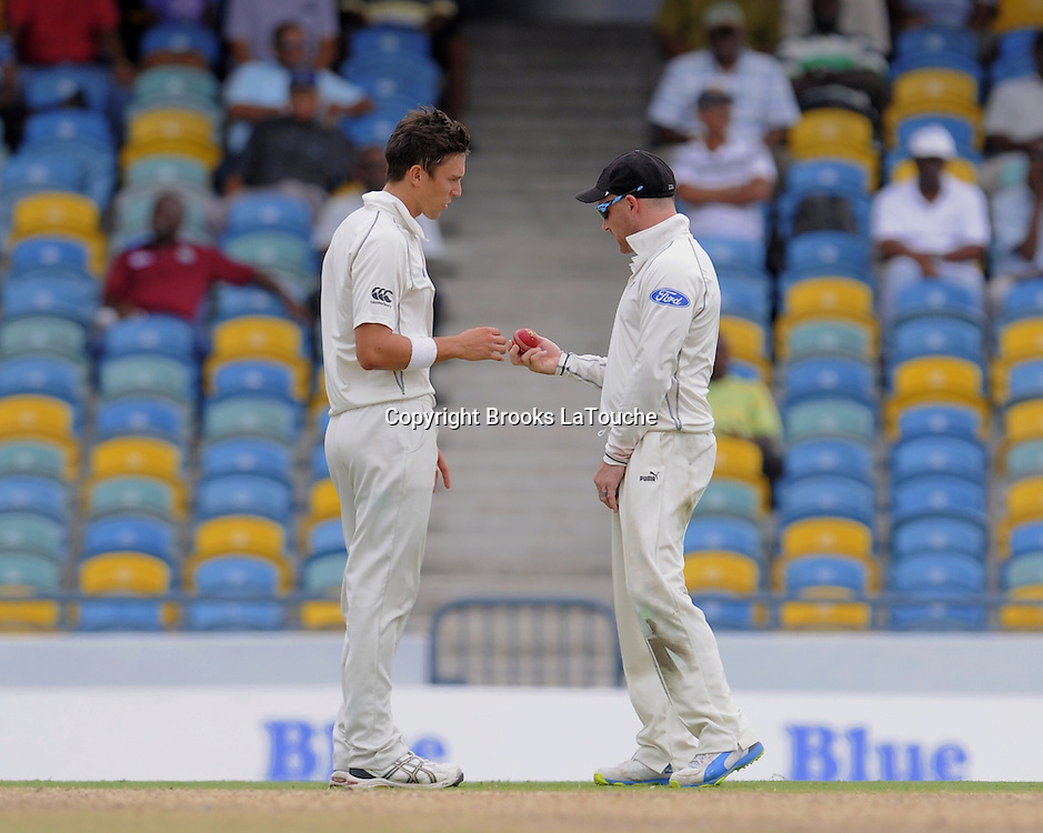 New Zealand bowler Trent Boult and captain Brendon McCullum make bowling plans during day two of the Third and Final Test West Indies v New Zealand at Kensington Oval, Barbados.<br /> Photo: Randy Brooks/www.photosport.co.nz