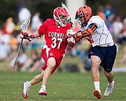 Cornell Big Red M Rocco Romero (37) is checked by Virginia Cavaliers M/A John Haldy (12).  The #1 ranked Virginia Cavaliers defeated the #4 ranked Cornell Big Red 14-10 at Klockner Stadium on the Grounds of the University of Virginia in Charlottesville, VA on March 8, 2009.