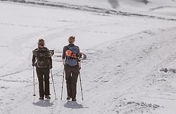 THEMENBILD - zwei Wanderinnen mit Stöcken und Schneeschuhen in ihren Rucksäcken, aufgenommen am 16. Februar 2019 in Maria Alm, Oesterreich // two hikers with sticks and snowshoes in their backpacks, in Maria Alm, Austria on 2019/02/16. EXPA Pictures © 2019, PhotoCredit: EXPA/Stefanie Oberhauser
