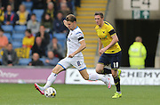 AFC Wimbledon midfielder Jake Reeves (8) plays a through ball during the Sky Bet League 2 match between Oxford United and AFC Wimbledon at the Kassam Stadium, Oxford, England on 10 October 2015.