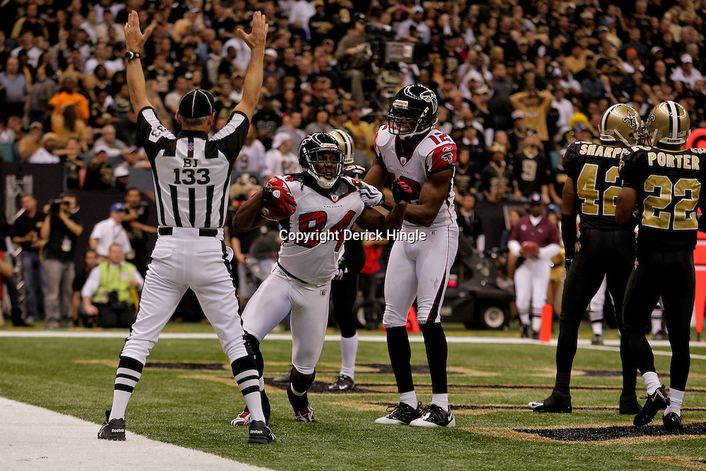 2009 November 02: Atlanta Falcons wide receiver Roddy White (84) celebrates with teammate Michael Jenkins (12) after scoring a second half touchdown against the New Orleans Saints during a 35-27 win by the Saints over the Falcons at the Louisiana Superdome in New Orleans, Louisiana.