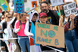 © Licensed to London News Pictures. 12/05/2019. London, UK. Demonstrators take part in the 'Mothers Rise Up' climate change demonstration in central London, calling for urgent action on climate change. The demonstration started at Hyde Park Corner and finished in Parliament Square. Photo credit : Tom Nicholson/LNP