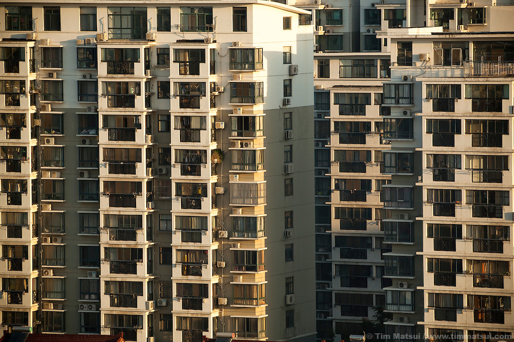 """Apartment blocks in the """"New City,"""" part of the expansion of Yangzhou, China, a suburb city of Shanghai and major producer of photovoltaic cells for the renewable energy solar power industry."""