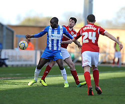 Colchester United's Jabo Ibehre holds the ball up against Bristol City's Brendan Moloney - Photo mandatory by-line: Dougie Allward/JMP - Mobile: 07966 386802 22/03/2014 - SPORT - FOOTBALL - Colchester - Colchester Community Stadium - Colchester United v Bristol City - Sky Bet League One